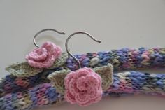Knitted covered coat hangers with crocheted rose for the school fete. https://www.facebook.com/SewThea