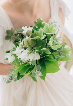 A white and green hellebore wedding bouquet | Brides.com