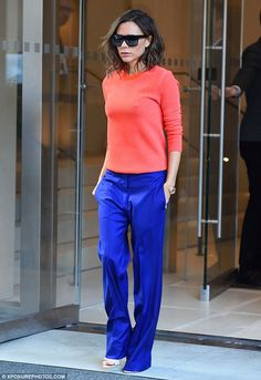 Victoria Beckham colour blocks vibrant coral sweater with blue flares : Stepping out: With New York Fashion Week well underway it was a suitably stylish Victoria Beckham who exited her hotel on Thursday morning. Moda Victoria Beckham, Victoria Beckham Outfits, Victoria Beckham Style, Fashion Week, Look Fashion, Fashion Outfits, Fashion Design, Fashion Trends, Coral Sweater