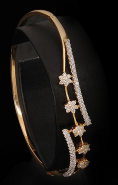 http://rubies.work/0241-ruby-rings/ Unique Diamond floral bangle