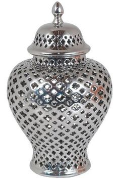 "Pierced Jar, 11"", SILVER by Home Decorators Collection. $29.00. Small: 11""H x 8"" diameter.. Large: 15""H x 9.5"" diameter.. The Pierced Jar combines a stunning silver finish, decorative lid and unique open mesh design for a pop of elegance that will look great in your home decor. Place one on your bookshelf as a decorative bookend, or on an accent table under the light as a shimmering decor piece. Try placing a candle inside for rich ambience that's perfect for any home decor. ..."