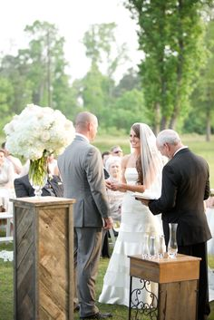 Private Texan ranch wedding with the ceremony in an open field with the trees as the gorgeous backdrop.