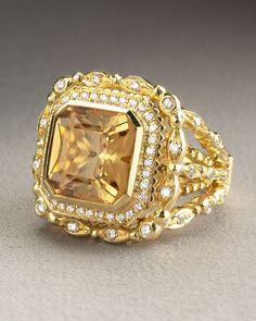 Gold and diamond citrine ring. Doris Panos   Daphne Citrine Ring   Cushion-cut citrine stone; 3.57 total carat weight. Pavé diamond border; VVS1 clarity