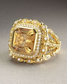 Gold and diamond citrine ring. Doris Panos   Daphne Citrine Ring   Cushion-cut citrine stone; 3.57 total carat weight. Pavé diamond border; VVS1 clarity