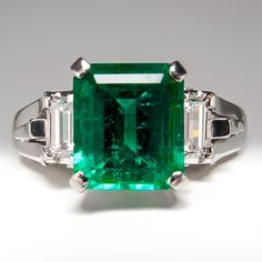 Emerald Engagement Ring w/ Baguette Diamond Accents in Platinum