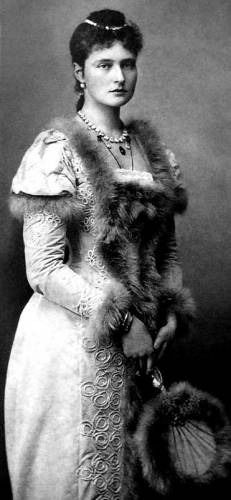 1892 Princess Alexandra fur trimmed dress..This photo shows more of the party dress worn by Princess Alexandra of Hesse in Hesse, including the upper puffed sleeves. Fur is used where lace would be while her curlicue bodice trim continues down toward her hem.