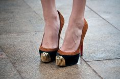 black and camel suede pumps with gold metallic tips.