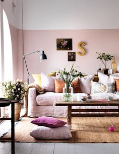 soft pink walls, skirted sofa, layered look so girly I love it
