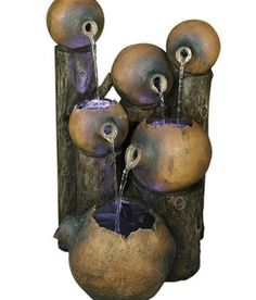 Water drops from earthware inspired pots, giving this LED illuminated fountain a natural, rustic feel. high x wide x deep. Umbria six pot rustic garden fountain. Style # at Lamps Plus. Decorative Water Fountain, Stone Water Features, Tabletop Fountain, Fountain Ideas, Pot Lights, Water Element, Rustic Gardens, Water Lighting, Diy Solar