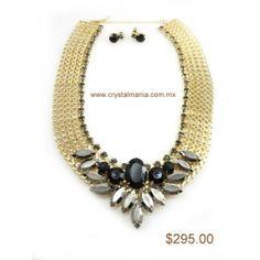 Set de collar y aretes en tono dorado con detalles en color gris y negro estilo 30263