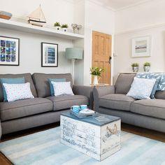 Modern living room with grey sofa