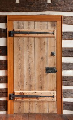 Log Cabin Doors | old barn in Woodstock, Va., were spliced together to create new doors ...