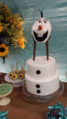 Olaf cake at a Frozen Fever birthday party! See more party planning ideas at CatchMyParty.com!