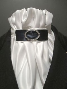 Equestrian Pzazz stock tie in white delustered satin with navy and diamante tab. Available from Equestrian Pzazz on Facebook www.facebook.com/eqpzazz