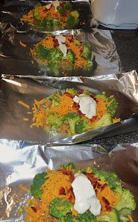 Chicken broccoli, ranch, cheese, and bacon in aluminum foil and placed in the oven...gotta try this.