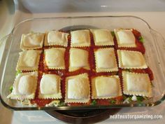 Super Easy make ahead Ravioli Lasagna! Layer frozen ravioli, sauce, mozzarella cheese, veggie. You can use Alfredo sauce and layer with spinach.