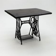 In a class of its own with its reclaimed wood table top and sewing machine bottom, this piece will grab the attention in any room. Dimensions  Length: 36 1/4 in. Width: 31 1/2 in. Height: 29 1/2 in.