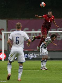 Portugal's defender Bruno Alves with Denmark's Martin Braithwaite in action during the UEFA EURO 2016 Qualifier match between Portugal…