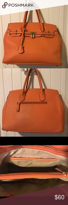 Huge orange purse bag!! Very large amount of space and has three compartments inside! Good condition one stain inside on one side. Perfect for girls who love big purses!! :) JustFab Bags Totes