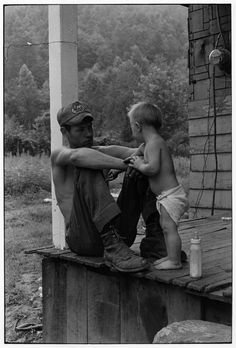 Man and child on porch, Eastern Kentucky, 1972. Photo by William Gedney.