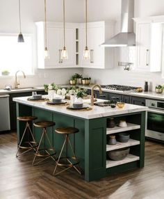 Really like the colour combo of deep green + brass fittings + wooden floor + light counter. Intrigued by use of white cabinets higher up and darker colour ones lower down to keep kitchen bright. Door styles suit the look. Also like the marble-look counter