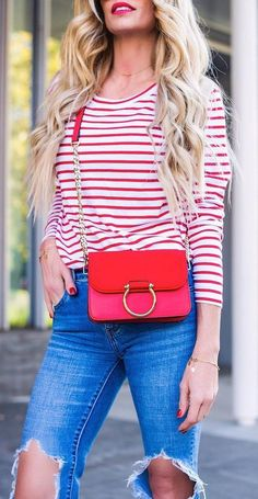 outfit of the day stripped top + red bag + rips