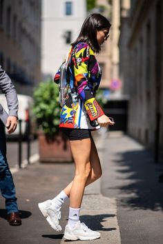 Kendall Jenner wearing Versace SS 91 Print Blazer Jacket, Alyx Silver  Leather Small Backpack 66c2fe5ffb