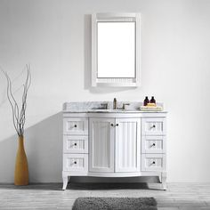 Topped with an opulent Carrara White marble countertop, the Vinnova Verona Vanity is a spectacular centerpiece for bathrooms of all sizes. Beadboard-style door faces accented by bronze-toned hardware lend a touch of old-fashioned beauty to this piece.