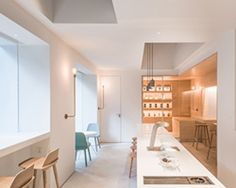 lukstudio creates a café and coworking space in a body of white boxes