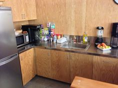 plywood kitchen with stainless steel counter