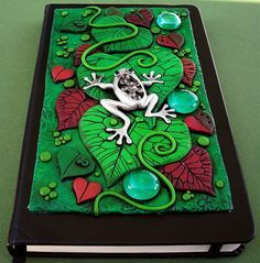 Polymer clay journal cover. Design the cover, bake and glue it on. Beautiful work, very colorful and so detailed.