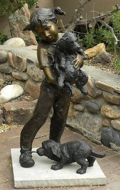 """Bronze Girl with two Puppies"" - photo by Charles Yurchak (Cha Li), via Flickr;  in New Mexico"