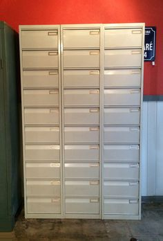 Vintage French Industrial Clapet Storage Cabinets. Circa 1970's. Three Clapet units together as one. Each Clapet cabinet has 10 compartments for storing anything you can imagine; books, shoes, linens, clothing, tools, etc. Original patina. A must have beauty for your industrial chic décor! Selling as one unit or can be separated. View the last photo to see what one unit looks like!  Industrielle Attitude 4763 Eagle Rock Blvd. Los Angeles, CA 90041 323-255-5124