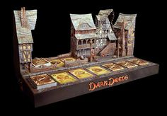 Dark Deeds has a very impressive looking display for Gen Con. Wargaming Terrain, Bookends, Tabletop, Display, Dark, Gallery, Floor Space, Table, Billboard