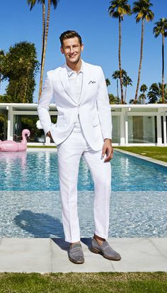 Fellas, all-white is totally alright in our book! If you want to rock this super stylish trend, try a linen suit with a polo shirt for a look that's comfy enough for the warmer weather and all about a laidback vibe — Perry Ellis