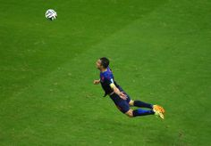 The Flying Dutchman - Robin van Persie of the Netherlands scores the teams first goal with a diving header in the first half during the 2014 FIFA World Cup Brazil Group B match between Spain and Netherlands at Arena Fonte Nova on June 13, 2014 in Salvador, Brazil. (Jeff Gross/Getty Images)