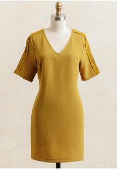 This mustard dress is perfect for a festive occasion or upcoming holiday party.