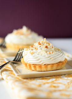 Mini coconut cream tarts - A creamy coconut custard blends harmoniously with buttery pie dough to create perfectly portioned miniature desserts that are full of coconut flavor. Mini Desserts, Just Desserts, Delicious Desserts, Dessert Recipes, Yummy Food, Dessert Tray, Coconut Custard, Coconut Cream, Toasted Coconut