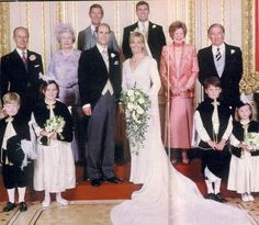 JUNE 19, 1999. With his sponsors or Best Men behind him, Prince Edward is photographed with his wife of a few minutes, Sophie Rhys-Jones.  To his right are his parents, The Duke of Edinburgh and Queen Elizabeth II.   The bride was gowned by Samantha Shaw.