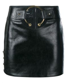 This black Anthony Vaccarello leather mini skirt is from the brand's striking new season collection which toyed with military influences. Crafted from butter soft leather, the piece has been cut to a figure-skimming short length, which sits high on the waist and showcases a circular cut out at the front which is elevated by an oversized gold ring and circular gold studs on the right hand side. Style yours with a sharply tailored blazer and monochrome separates to emulate the brand's sultry…