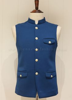 Get yourself adorned with this stunning waistcoat in blue color made with xyz fabric. It is designed with a mandarin collar, attractive buttons and unique flapped pocket style on the chest and waist. Designer Suits For Men, Designer Clothes For Men, Wedding Wear, Wedding Suits, Fashion Suits, Men's Fashion, Stylish Waistcoats, Marriage Suits, Luxury Font