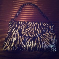 Black and silver clutch w/ detachable strap Purchased from a small business boutique owner at a trunk show! Bag is perfect for day or night! Strap can be removed and comes with dustbag. Bag is in excellent condition. Worn once!! Bags