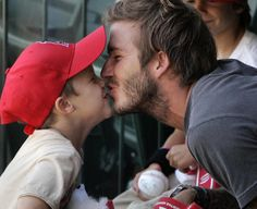 beckham...he's hot & he's cute with his kid.  talk about perfection