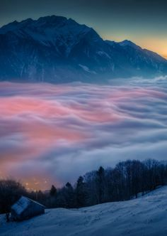 Fog over small town in Switzerland