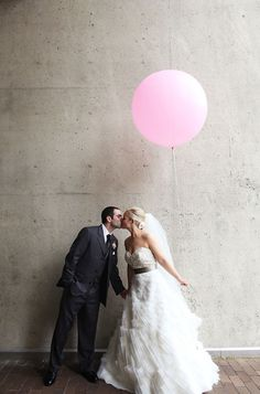 If you're not into flowers, maybe balloons? I'm normally against balloons in all way, but have seen some cute wedding photos lately with them.