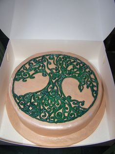 Tree of life grooms cake. I think you could take this design and incorporate it into a wedding cake and carry it throughout the decor.