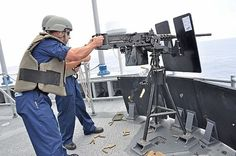 CARIBBEAN SEA (Sept. 10, 2013) Fire Controlman 1st Class Steven Everley and Gunner's Mate 1st Class Mark Marasek fire a .50-caliber machine gun during a live-fire exercise aboard the guided-missile frigate USS Rentz (FFG 46) during the annual UNITAS multinational maritime exercise. (U.S. Navy photo by Lt. Cmdr. Corey Barker/Released)