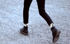 Cropped pants over ankle boots. Black