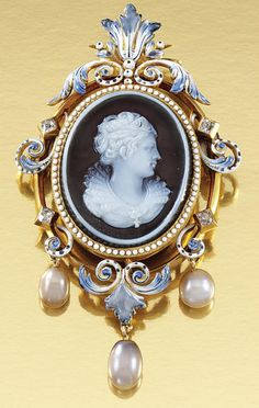 Late 19th century gold, onyx, cameo enamel, pearl and diamond brooch/pendant. Inset to the centre with an oval onyx cameo carved to depict the dextral profile of a maiden in Renaissance dress, within an open work scroll frame of blue and white enamel, embellished with circular-cut diamonds, suspending three pearl drops, to a glazed locket reverse.