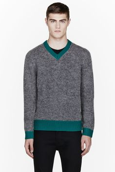 ACNE STUDIOS //  Grey alpaca-blend Wood sweater  32129M056001  Long sleeve knit alpaca blend sweater in grey. Ribbed knit contrasting v-neck collar, cuffs, and hem in teal. Tonal stitching. 48% nylon, 39% wool, 13% alpaca. Hand wash. Imported.  $390 CAD